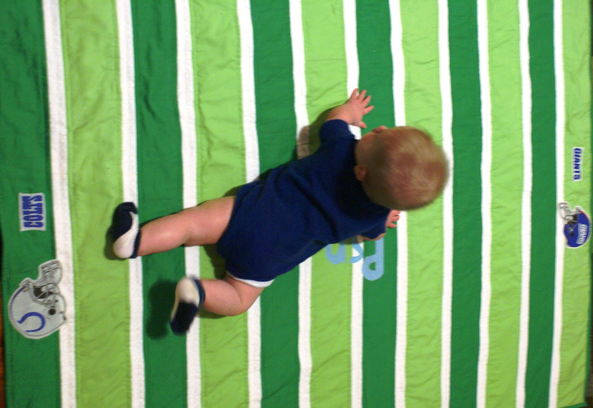 a5578d477ea ... of big projects and I want something functional for our home. quilted  football playmat