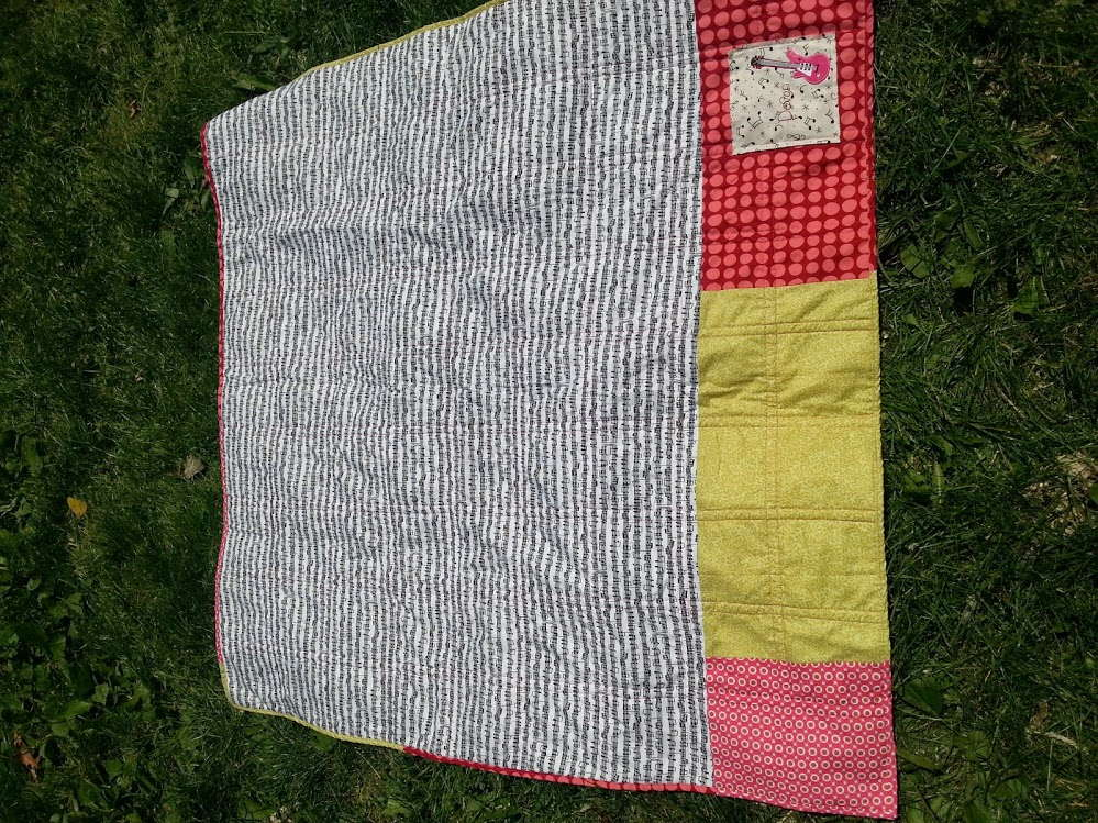 pink and green scrappy baby quilt 1