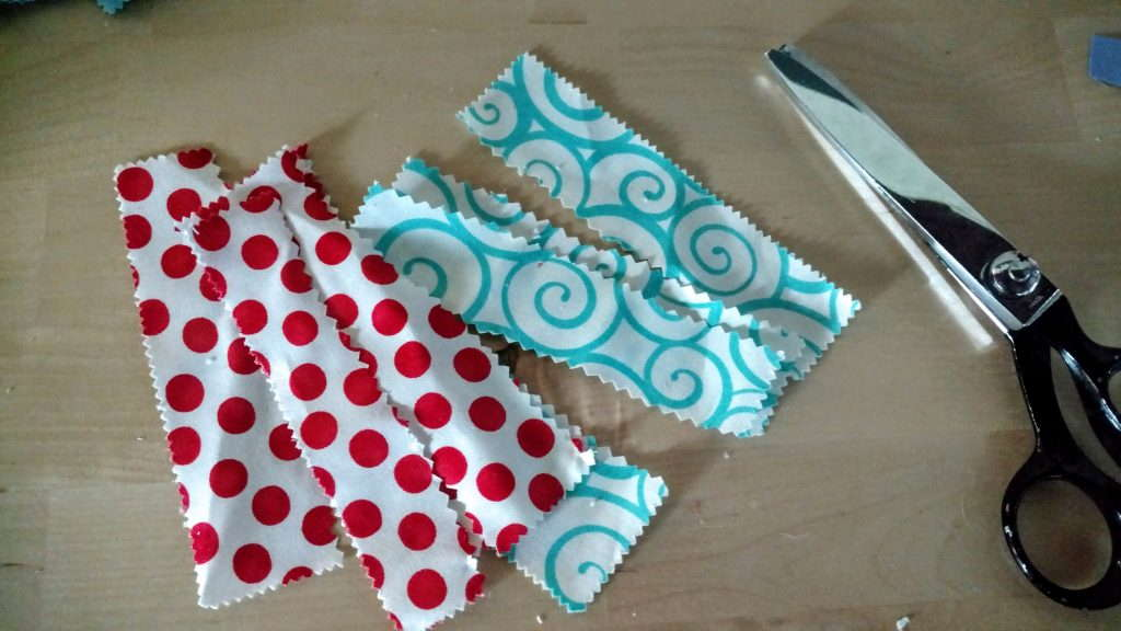 cutting strips from charms