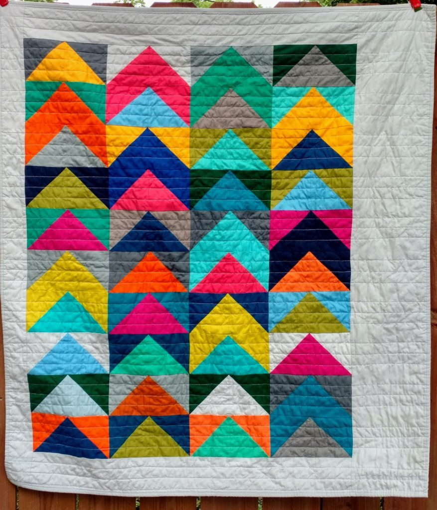 Kona solids baby quilt by quiltytherapy. #Half square triangle quilt #solids quilt #kona solids #HST quilt #modernbabyquilt