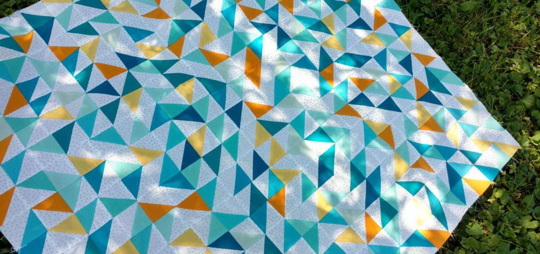 baby quilt, scrap quilt, solids quilt, modern quilt, half square triangles