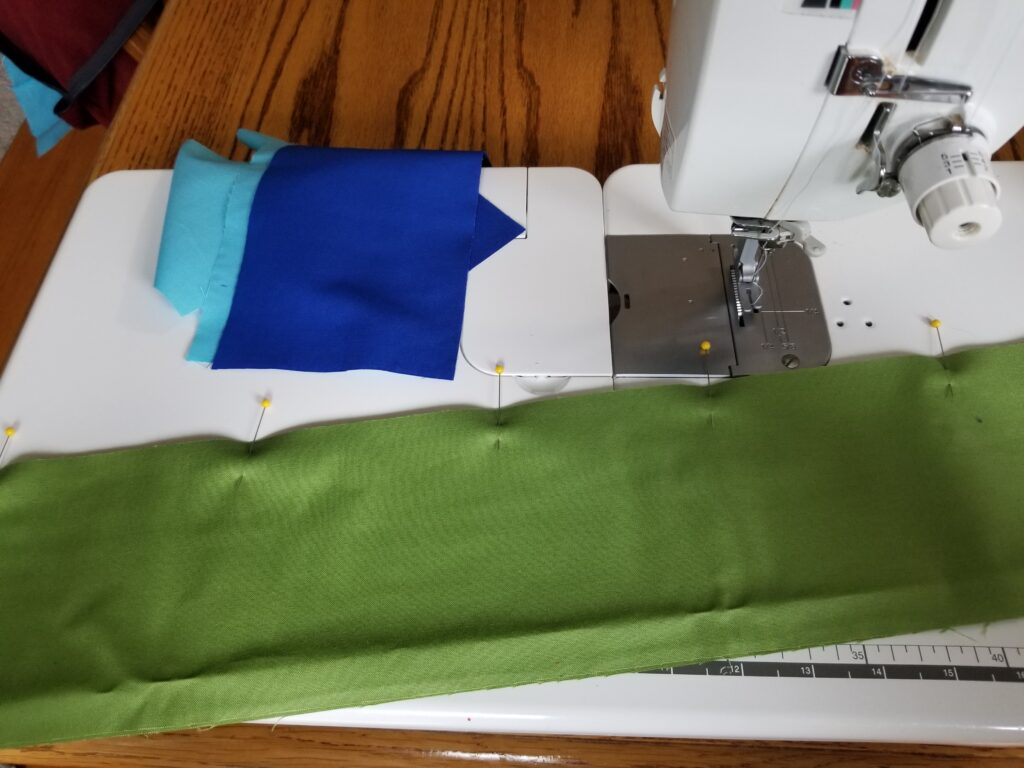 strips of fabric pinned together