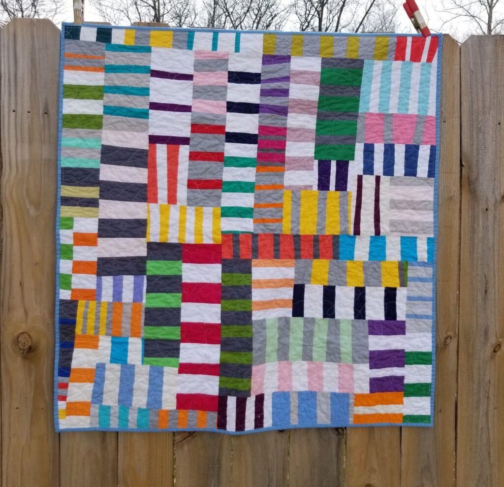 solid quilt, scrappy quilt